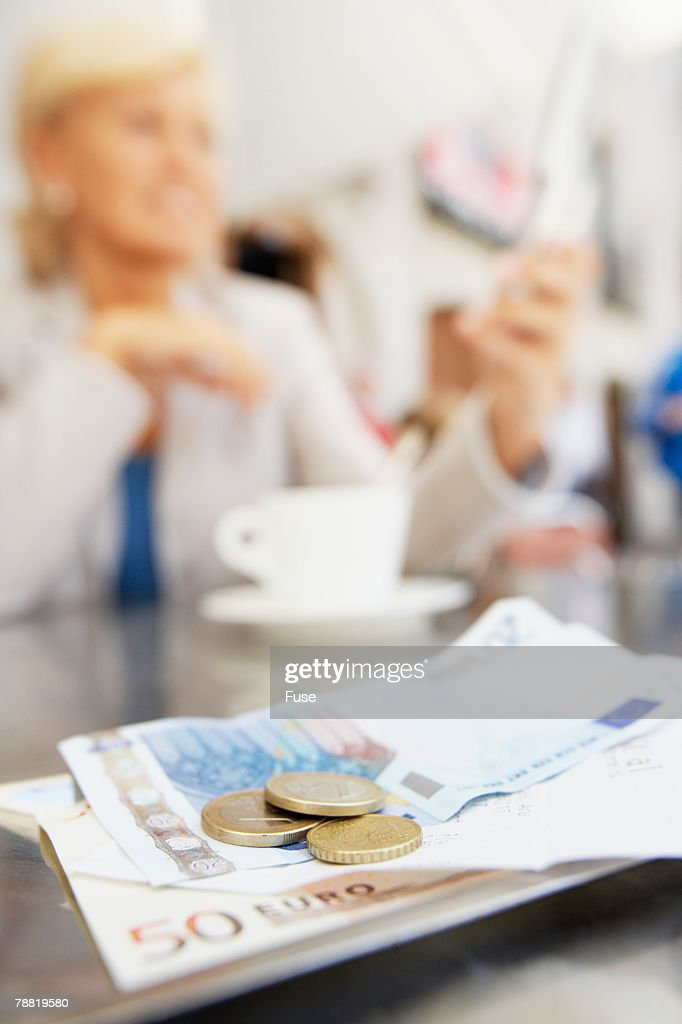 Money on Table in Cafe