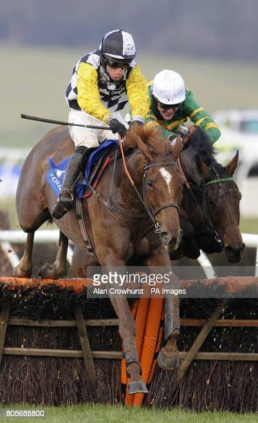 Money Order ridden by Tony McCoy jump the last in second but go on to win The coralcouk Hadicap Hurdle from Strategic Approach ridden by Wayne...