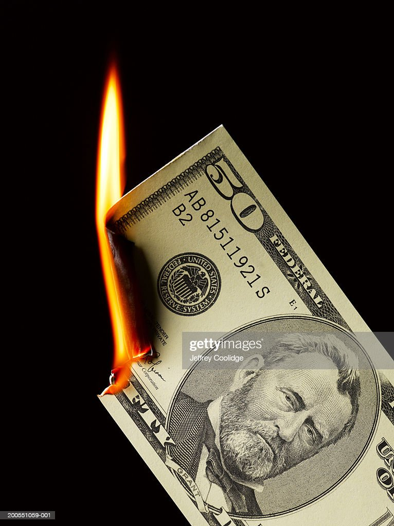 Money paper currency burning : Stock Photo