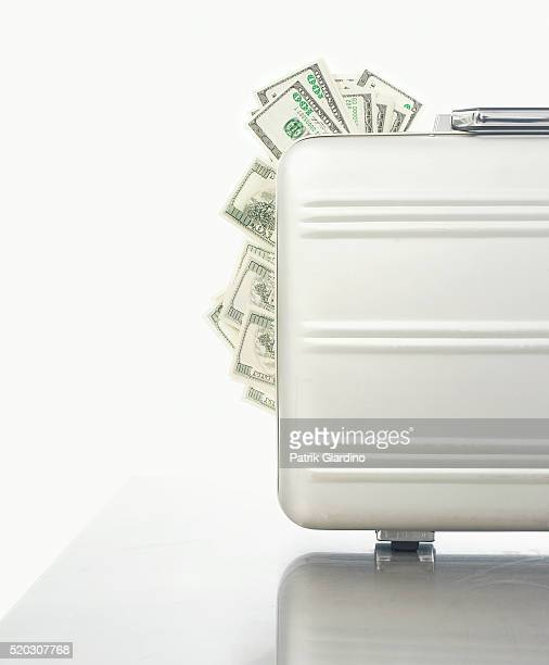 Money Sticking Out of Briefcase