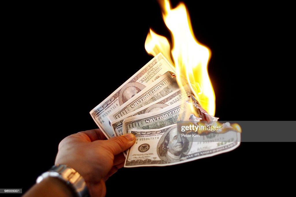 Money to burn : Stock Photo
