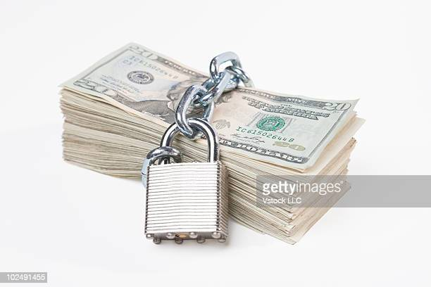 Money with a lock around it