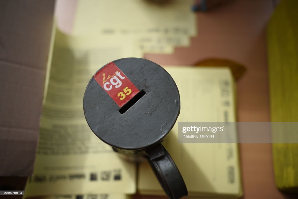 A money-box for the General Confederation of Labour (CGT) is pictured in Fougeres, western France on May 31, 2016, during a visit of CGT union's secretary-general. French secretary-general of the General Confederation of Labour (CGT) worker's union Philippe Martinez declared that the CGT filed a lawsuit for defamation against the head of France's bosses' federation. French employers' association Medef Pierre Gattaz accused unions of behaving like 'terrorists', as the fresh industrial unrest was set to hit transport just days before fans begin arriving for the start of the football championships on June 10. / AFP / DAMIEN