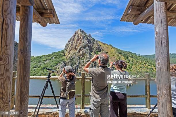 MonfragÙe National Park Caceres Province Extremadura Spain Bird watchers at the Salto del Gitano the Gipsy's Leap