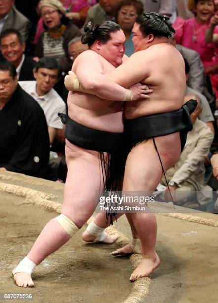 Monglian ozeki Terunofuji pushes ozeki Goeido out of the ring to win during day nine of the Grand Sumo Summer Tournament at Ryogoku Kokugikan on May...