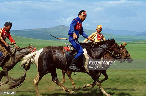 Mongolian child jockeys ride through the grasslands at a horserace during the Naadam festival The young jockeys can ride up to 30 kilometers in the...