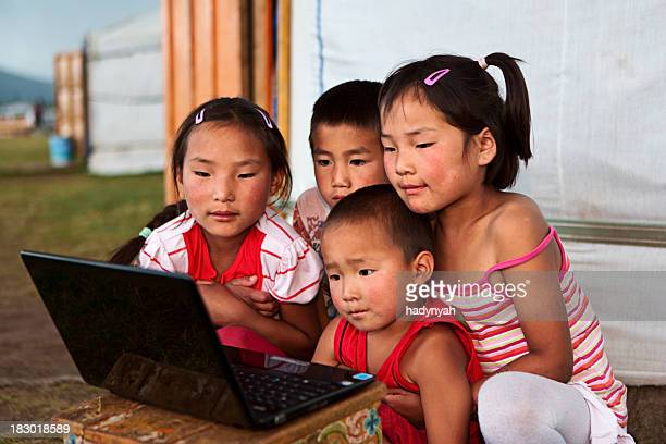 Mongolian children using laptop