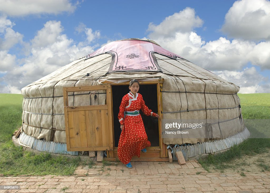 Mongolian Girl stepping out of her Yurt in Inner M : Stock Photo