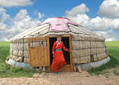 Mongolian Girl stepping out of her Yurt in Inner M