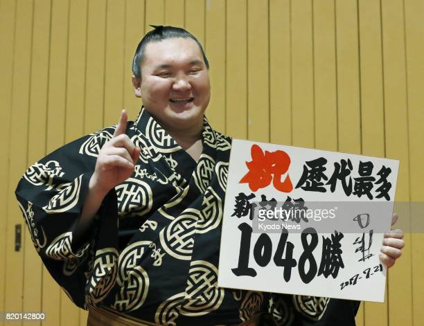 Mongolian grand champion Hakuho poses after claiming a record 1048th career win at the Nagoya Grand Sumo Tournament in Nagoya central Japan on July...