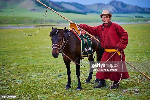 Mongolian horserider in the steppe