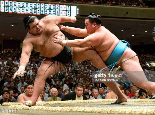 Mongolian komusubi Tamawashi pushes ozeki Takayasu out of the ring to win during day two of the Grand Sumo Autumn Tournament at Ryogoku Kokugikan on...
