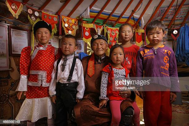Mongolian man with grand children in Gobi Desert