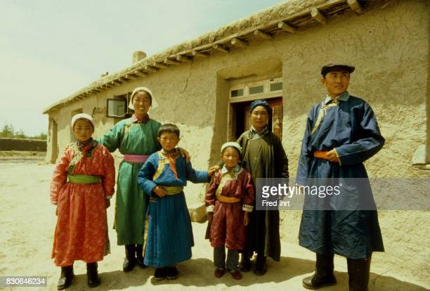 Mongolian nomad teacher with her family in front of her house Family portrait