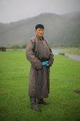Mongolian Nomad wearing tradional deel dress