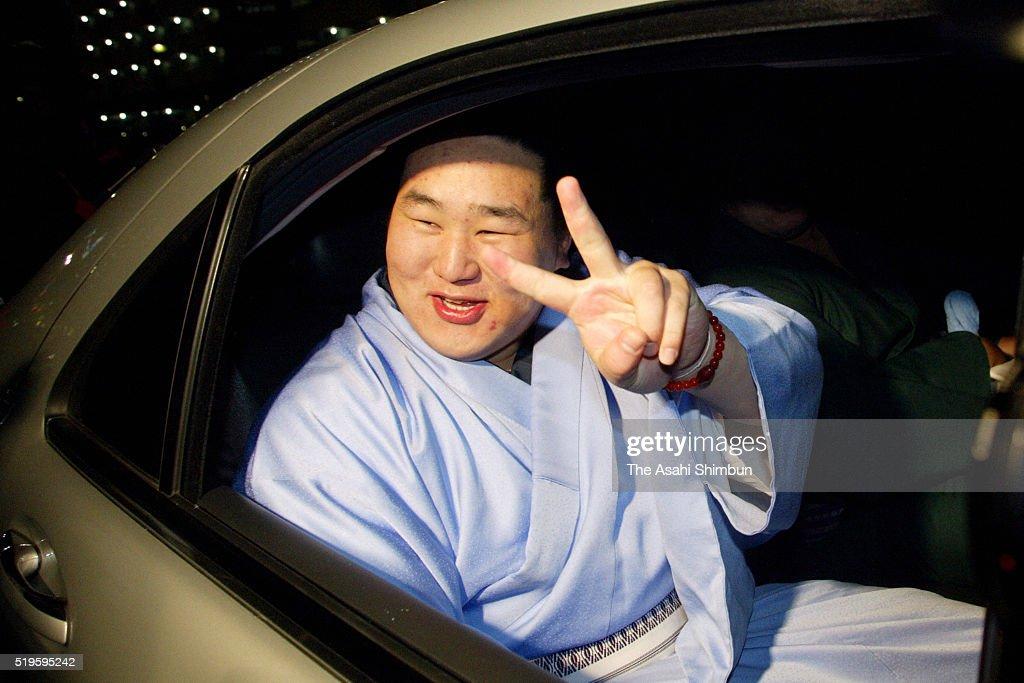Mongolian ozeki Asashoryu celebrate winning the tournament after day thirteen of the Grand Sumo Kyushu Tournament at the Fukuoka Convention Center on...