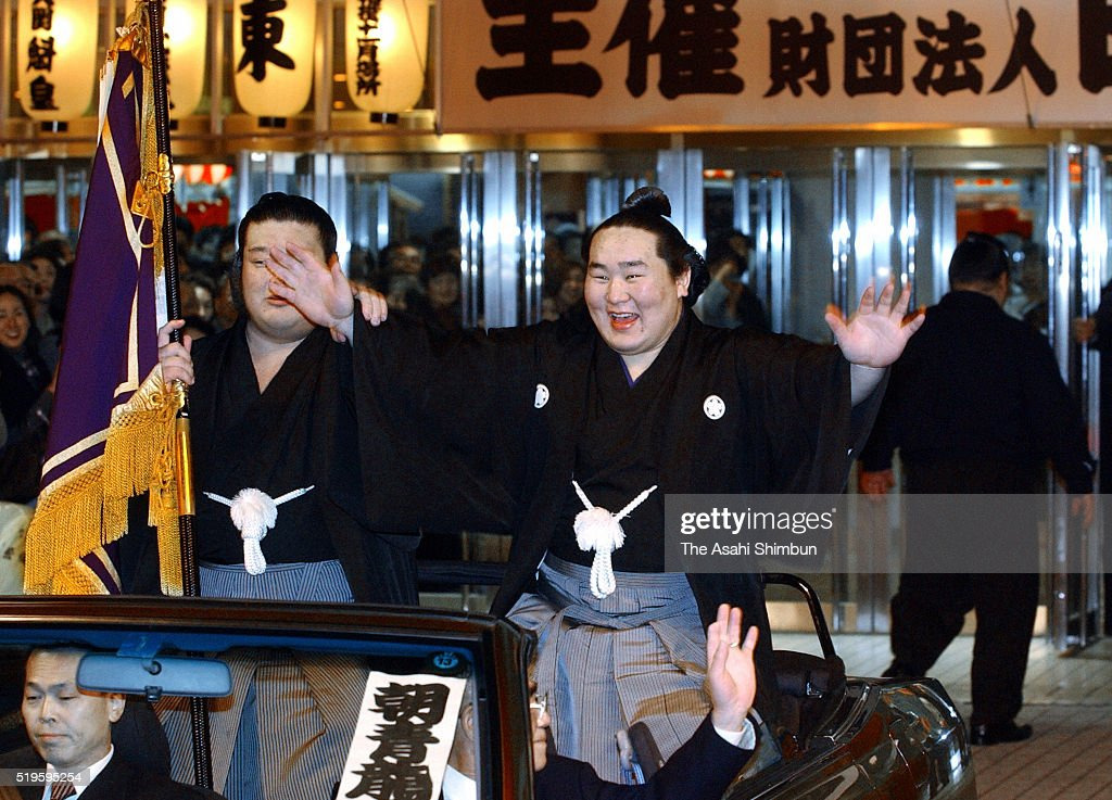 Mongolian ozeki Asashoryu celebrates winning the tournament at the victory parade during day fifteen of the Grand Sumo Kyushu Tournament at the...