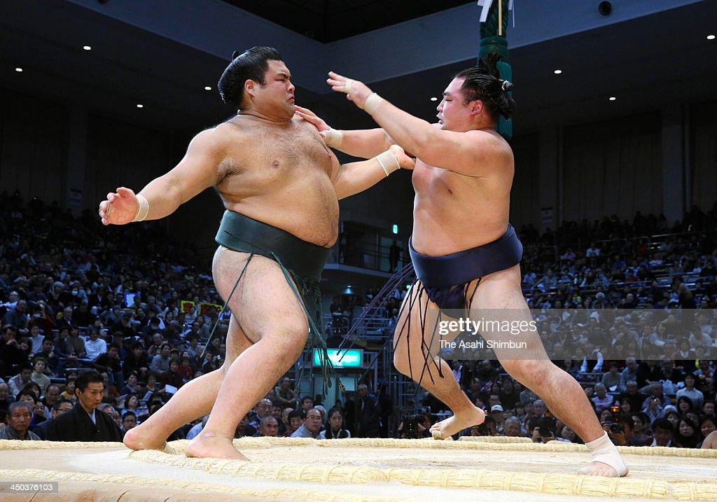 Mongolian ozeki Kakuryu (R) whose real name is Mangaljalavyn Anand beats Takayasu during day eight of the Grand Sumo Kyushu Tournament at Fukuoka Convention Center on November 17, 2013 in Fukuoka, Japan.