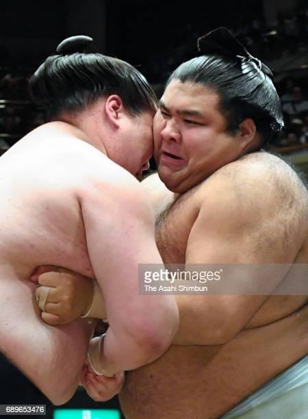 Mongolian ozeki Terunofuji and sekiwake Takayasu compete during day fifteen of the Grand Sumo Summer Tournament at Ryogoku Kokugikan on May 28 2017...