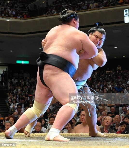 Mongolian ozeki Terunofuji throws sekiwake Takayasu to win during day fifteen of the Grand Sumo Summer Tournament at Ryogoku Kokugikan on May 28 2017...