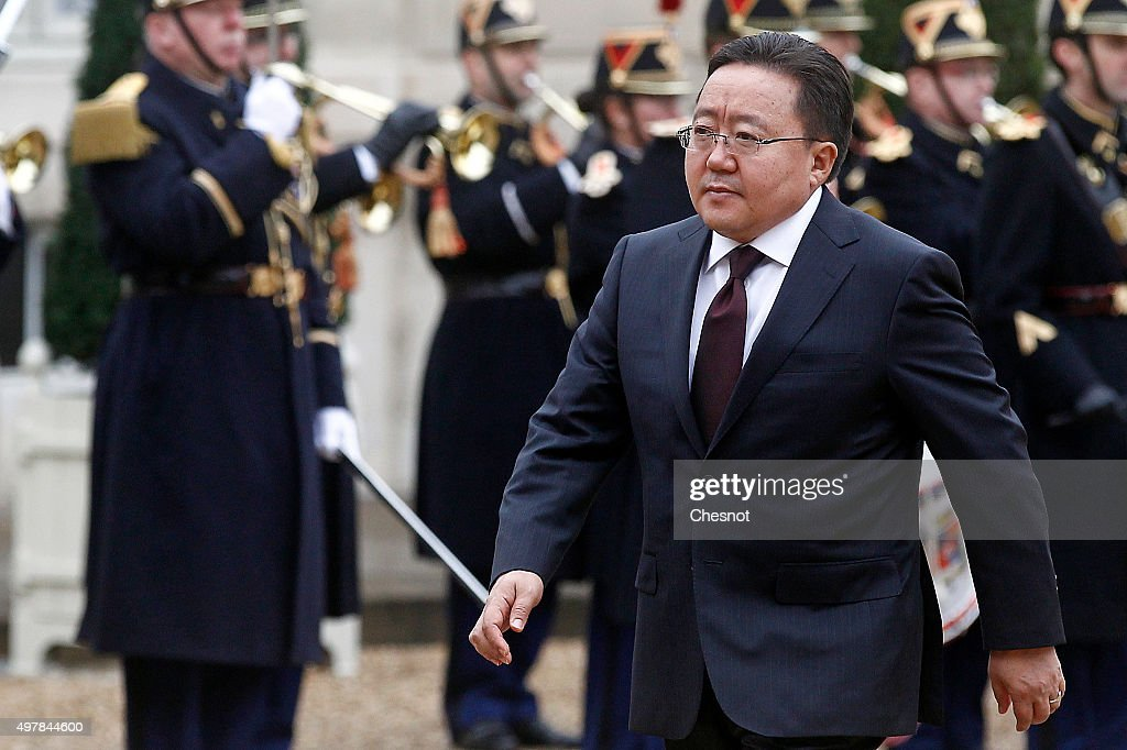 Mongolian President <a gi-track='captionPersonalityLinkClicked' href=/galleries/search?phrase=Tsakhiagiin+Elbegdorj&family=editorial&specificpeople=5427078 ng-click='$event.stopPropagation()'>Tsakhiagiin Elbegdorj</a> walks past Republican Guards as he arrives before his meeting with French President Francois Hollande at the Elysee Palace on November 19, 2015 in Paris, France.