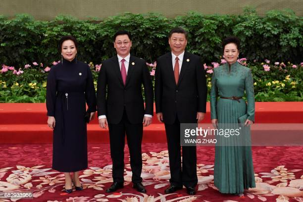 Mongolian Prime Minister Jargaltulgyn Erdenebat and his wife pose with Chinese President Xi Jinping and his wife Peng Liyuan during a welcome...