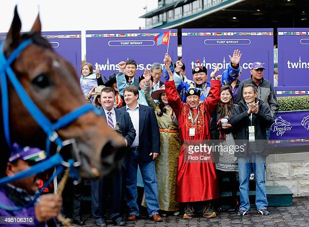 Mongolian Saturday enters the winner's circle as the winning connections celebrate their Breeders' Cup Turf Sprint win at Keeneland Racecourse on...