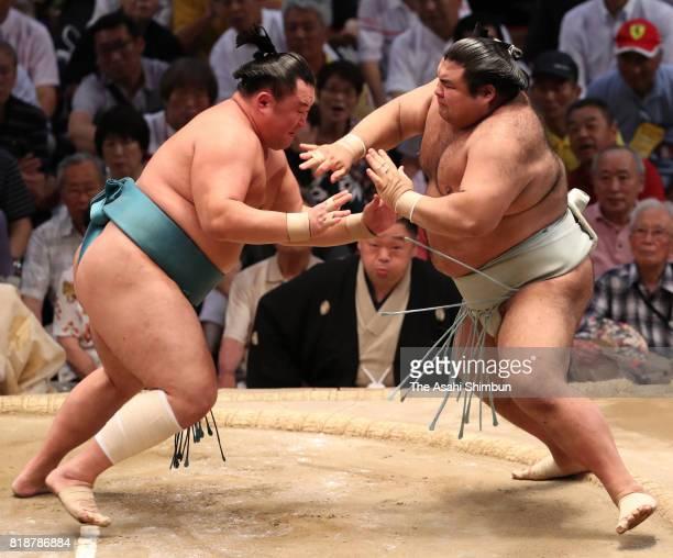 Mongolian sekiwake Tamawashi pushes ozeki Takayasu out of the ring to win during day eleven of the Grand Sumo Nagoya Torunament at Aichi Prefecture...
