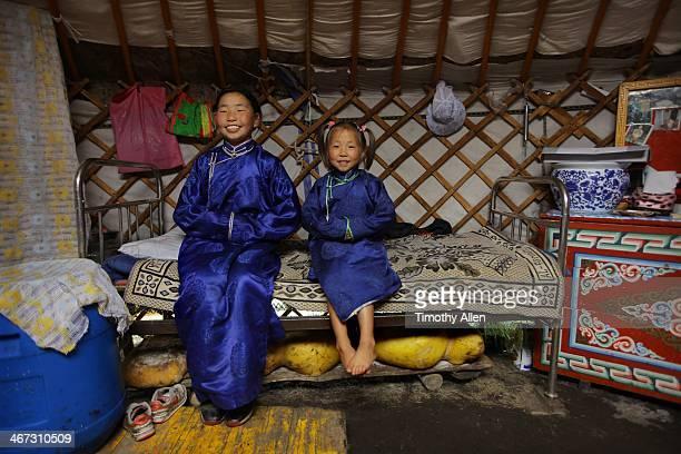 Mongolian sisters wearing traditional deel dress