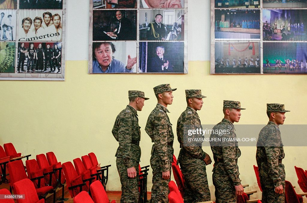 Mongolian soldiers stand in a polling booth after voting in the Mongolian parliamentary election in Ulan Bator on June 29, 2016. Mongolians headed to the polls on June 29 to elect a new national government as the country struggles to monetise its vast natural resources amid slumping demand for commodities from its largest trade partner China. / AFP / BYAMBASUREN