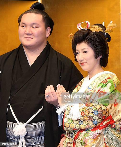 Mongolian sumo grand champion or Yokozuna Hakuho and his wife Sayoko pose for photgraphs during a press conference prior to their wedding at a Tokyo...