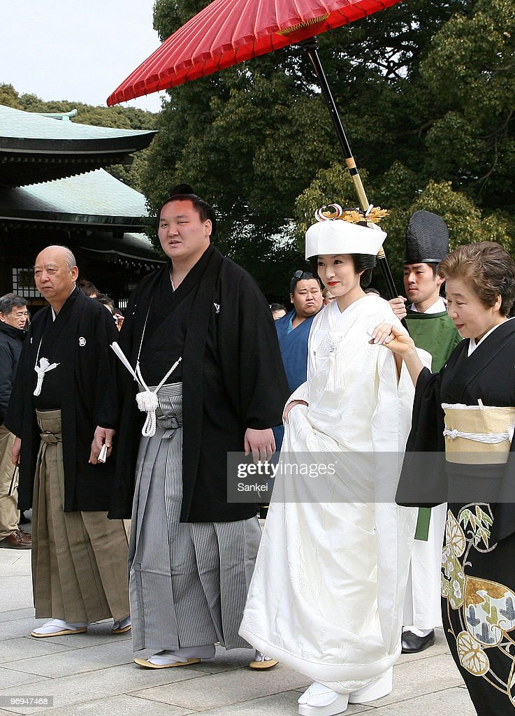 Mongolian sumo grand champion, or Yokozuna Hakuho (L) and his wife Sayoko attend their wedding at a Meiji-jingu shrine on February 21, 2010 in Tokyo, Japan.