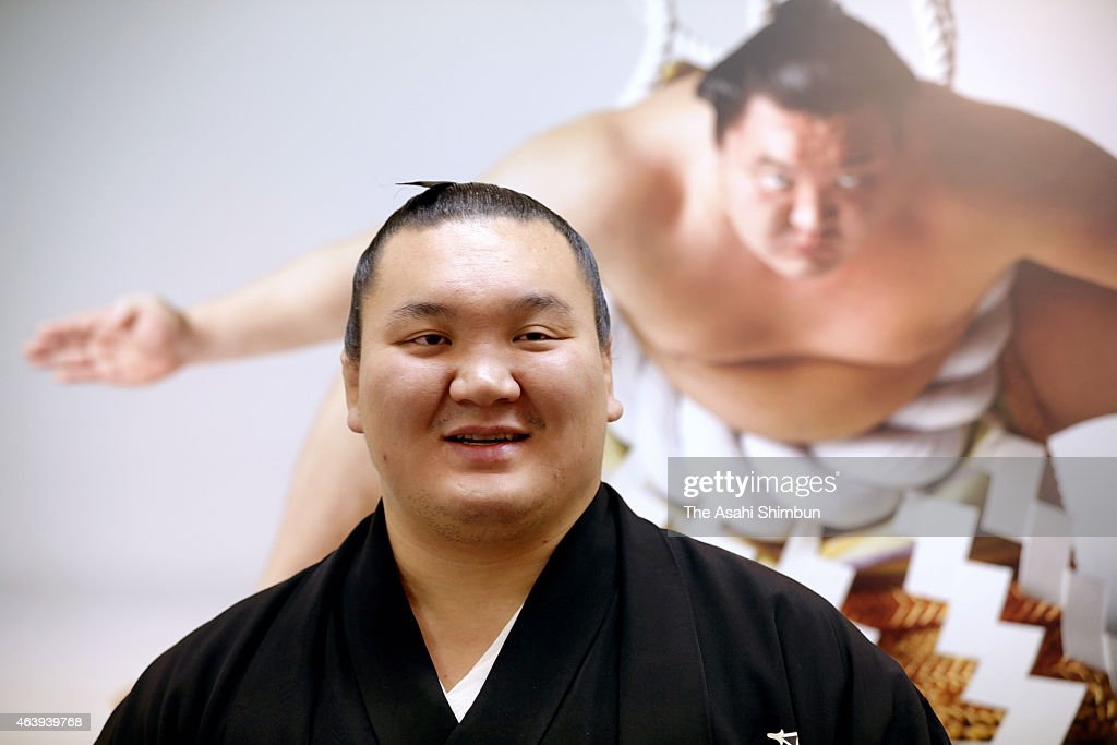 Mongolian sumo yokozuna, grand champion <a gi-track='captionPersonalityLinkClicked' href=/galleries/search?phrase=Hakuho&family=editorial&specificpeople=625611 ng-click='$event.stopPropagation()'>Hakuho</a> attends his photo exhibition at Yurakucho Marion on February 20, 2015 in Tokyo, Japan.