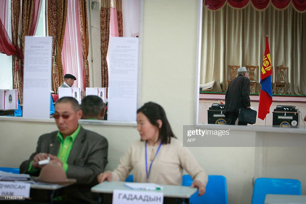 Mongolian voters fill in forms at a polling station during presidential elections in Ulan Bator on June 26, 2013. Mongolians voted on June 26 in a presidential election pitting the front-running incumbent against a champion wrestler and a woman, amid calls for a fairer distribution of the former Soviet satellite's spectacular mining wealth.