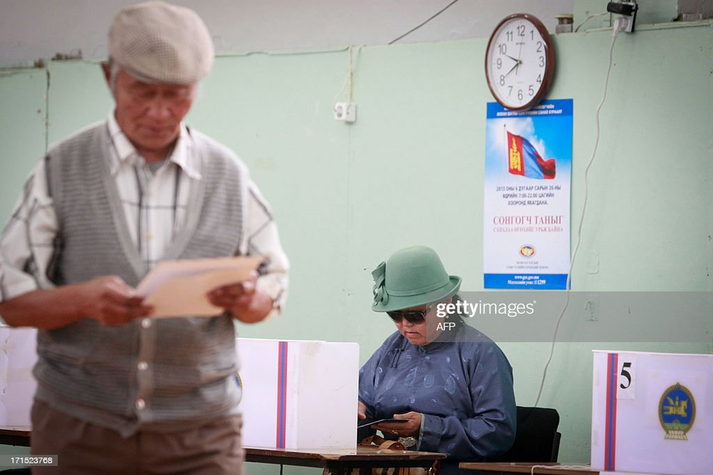 Mongolian voters fill in their ballots at a polling station during presidential elections in Ulan Bator on June 26, 2013. Mongolians voted on June 26 in a presidential election pitting the front-running incumbent against a champion wrestler and a woman, amid calls for a fairer distribution of the former Soviet satellite's spectacular mining wealth.