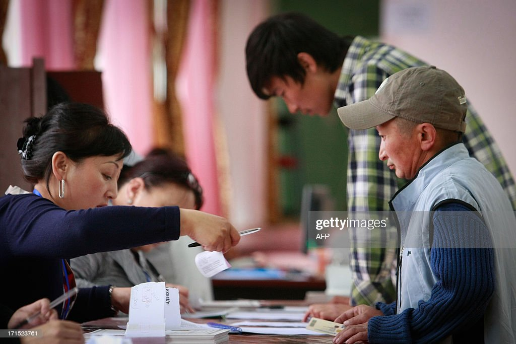 Mongolian voters prepare their ballots at a polling station during presidential elections in Ulan Bator on June 26, 2013. Mongolians voted on June 26 in a presidential election pitting the front-running incumbent against a champion wrestler and a woman, amid calls for a fairer distribution of the former Soviet satellite's spectacular mining wealth.