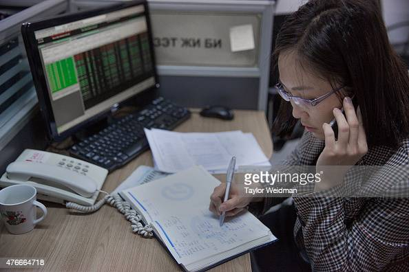 Mongolian woman works in the Mongolian Stock Exchange on June 11 2015 in Ulaanbaatar Mongolia A few years ago Mongolia boasted one of the world's...
