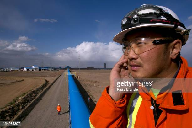 Mongolian worker looks out from operations along the blue conveyor belt that moves rock from the crusher to the concentrator area at the Oyu Tolgoi...