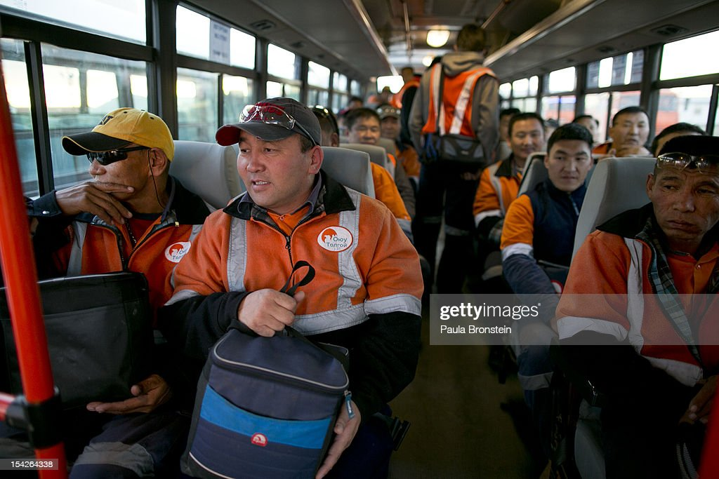 Mongolian workers take a bus to start work at the Oyu Tolgoi mine October 12, 2012 in the south Gobi desert, Khanbogd region, Mongolia. The Oyu Tolgoi (Mongolian for Turquoise Hill) copper and gold mine is a combined open pit and underground mining project. The site, discovered in 2001, is located approximately 550 km south of the Mongolian capital, Ulan-Batar in the South Gobi Desert. Turquoise Hill Resources (Formerly Ivanhoe Mines) and Rio Tinto signed a long-term comprehensive investment agreement with the Government of Mongolia in 2009 with the deal awarding Turquoise Hill Resources, whose majority shareholder is Rio Tinto, with a controlling 66 percent interest and The Mongolian Government with a 34 percent interest in the project. Rio Tinto provided a comprehensive financing package and assumed direct management of the project under an agreement with Ivanhoe Mines. Initial production from open pit mining is currently underway and commercial production is planned to start in first half of 2013. An 85million USD investment was earmarked for education and training projects, with Mongolians expected to constitute 90 percent of the work force when production begins in 2013. When Oyu Tolgoi starts fully operating Mongolia will be set to become one of the world's top copper and gold producers with production estimates of 450,000 tons of copper and 330,000 ounces of gold annually. Mongolia is currently the world's fastest growing economy with its GDP increasing by more than 17 percent last year and an estimated $1.3 trillion in untapped mineral resources. Oyu Tolgoi is Mongolia's largest foreign investment project and the country's biggest economic undertaking to date, which is projected to add one-third of future value to the country's GDP by 2020.