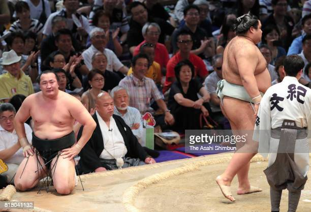 Mongolian wrestler Chiyoshoma shows dejection after his defeat by ozeki Takayasu during day eight of the Grand Sumo Nagoya Torunament at Aichi...