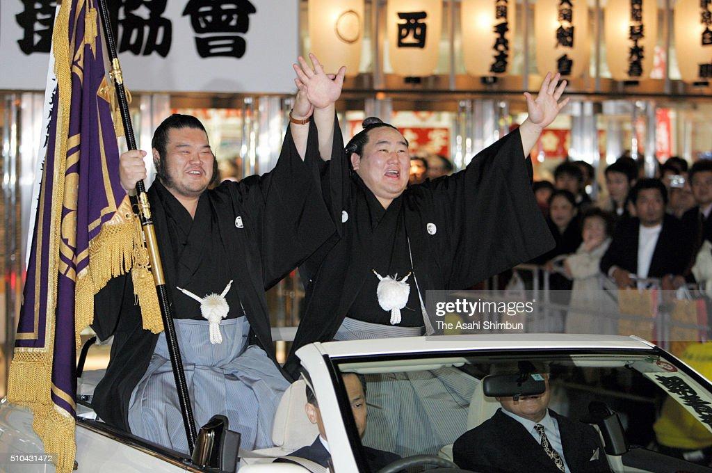 Mongolian yokozuna Asashoryu celebrates winning the Grand Sumo Kyushu Tournament at the winning parade from the Fukuoka Convention Center on November...