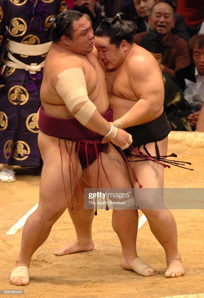 Mongolian yokozuna Asashoryu pushes Chiyotaikai to win during day fifteen of the Grand Sumo Kyushu Tournament at Fukuoka Convention Center on...