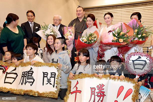Mongolian yokozuna Hakuho celebrates his 1000th win after day three of the Grand Sumo Kyushu Tournament at Fukuoka Convention Center on November 15...