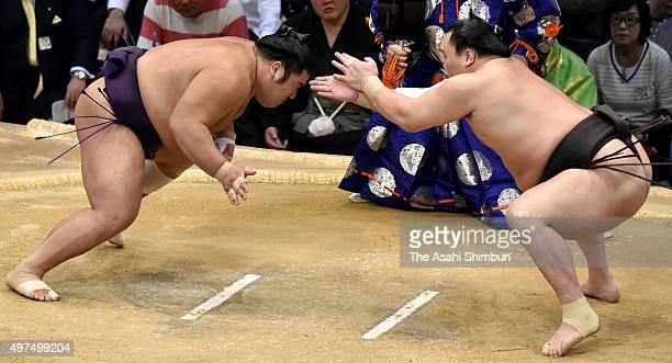 Mongolian yokozuna Hakuho claps his hands in front of Tochiozan during day ten of the Grand Sumo Kyushu Tournament at Fukuoka Convention Cetner on...