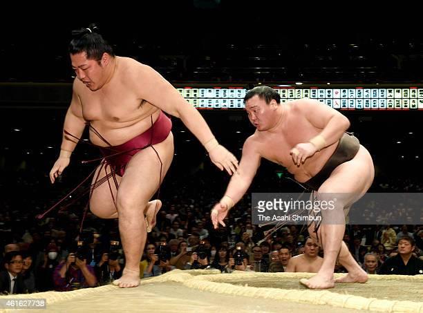 Mongolian yokozuna Hakuho pushes Endo out of the ring to win during day six of the Grand Sumo New Year tournament at Ryogoku Kokugikan on January 16...