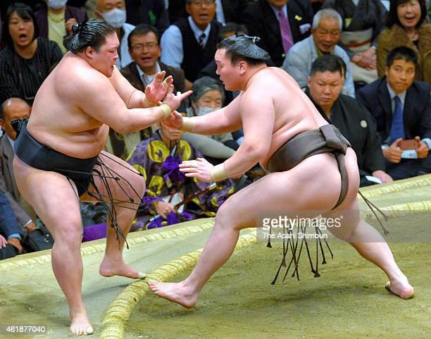 Mongolian yokozuna Hakuho pushes ozeki Goeido out of the ring to win during day eleven of the Grand Sumo New Year Tournament at Ryogoku Kokugikan on...