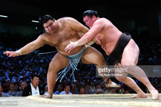 Mongolian yokozuna Hakuho pushes ozeki Takayasu to achieve the record 1048th career win during day thirteen of the Grand Sumo Nagoya Torunament at...