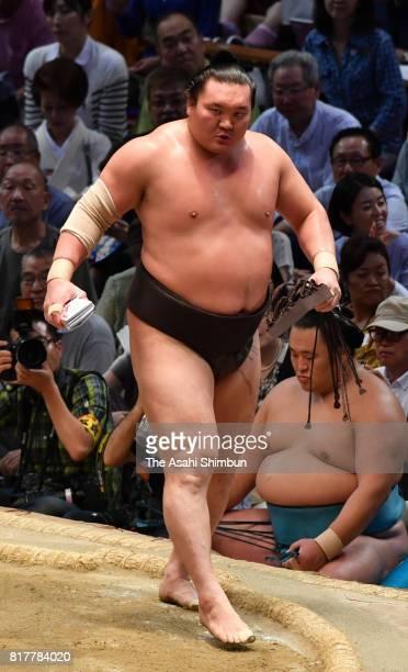 Mongolian yokozuna Hakuho reacts after his victory over Mongolian wrestler Chiyoshoma during day ten of the Grand Sumo Nagoya Torunament at Aichi...