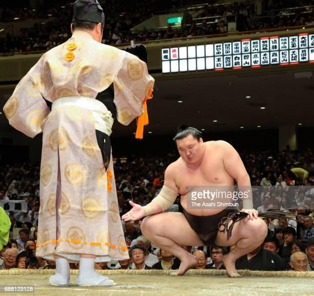 Mongolian yokozuna Hakuho reacts after his victory over ozeki Goeido during day eleven of the Grand Sumo Summer Tournament at Ryogoku Kokugikan on...
