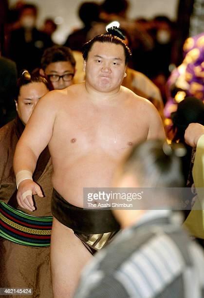 Mongolian yokozuna Hakuho returns to the dressing room after his 33rd career win during day thirteen of the Grand Sumo New Year Tournament at Ryogoku...